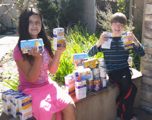 Jared and sister Destiny collect food for Got Your Back San Diego.